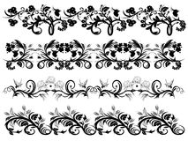 Plant Ornaments. Plant designs with swirls, flowers and birds Royalty Free Stock Image