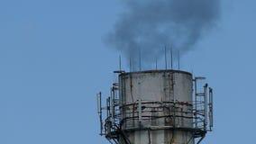 Plant pipe  smoke black against blue sky stock video
