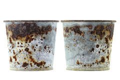 Plant pots full of flaky coating of iron oxide. Rusty plant pots full of reddish brown flaky coating of iron oxide Royalty Free Stock Photo