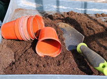Plant pots and trowel in compost. Stock Image