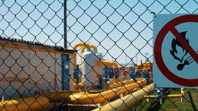 Plant for processing natural gas. Warning of fire hazard on the fence. Transportation and processing of natural gas stock video footage