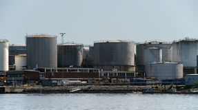 Plant for the processing of petroleum products and the production of fuel and lubricants. Fuel tanks on the shore.  stock images