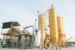 Plant for production of concrete with silos and excavator. Stock Photo
