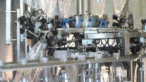 Plant for the production of mineral water. Water bottling in plastic white.  stock video footage