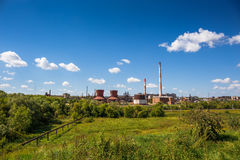 Plant for the production of synthetic rubber, the plant on nature background landscape. Plant for the production of synthetic rubber in Efremov, Russia, the Stock Photo