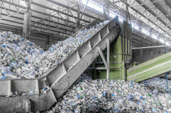 A plant for recycling bottles. Escalator with a pile of plastic bottles at the factory for processing and recycling. PET recycling plant Stock Image