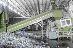 A plant for recycling bottles. Escalator with a pile of plastic bottles at the factory for processing and recycling. PET recycling plant Stock Photo