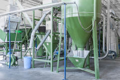 A plant for recycling bottles. Factory equipment for processing and recycling of plastic bottles. PET recycling plant Royalty Free Stock Photos
