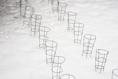 Plant support cone-shaped cages in fresh spring snow Royalty Free Stock Photography