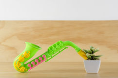 Plant and toy saxophone Royalty Free Stock Photos