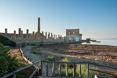 Plant for tuna fishing ruins. Ruins of an old plant for tuna fishing and processing in the dawn with still sea on the background Stock Photos