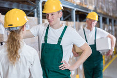Plant workers wearing safety helmets. And overalls Stock Photo