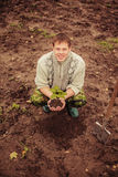 Plant. The young man plants a tree stock photo