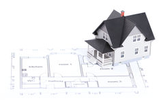 Planta da construção com modelo da casa Fotografia de Stock