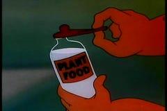 A planta de alimentação com garrafa de bebê encheu-se com o alimento de planta ilustração stock