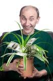 Planta de dinheiro da terra arrendada do homem idoso Imagens de Stock Royalty Free