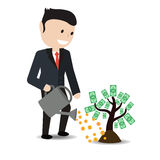 Planta de riego del hombre de negocios con las hojas del dólar Imagen de archivo
