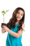 Planta de semillero de la explotación agrícola de la muchacha Fotos de archivo libres de regalías
