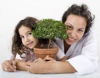 Planta del niño del profesor Imagen de archivo libre de regalías