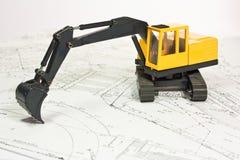Planta e máquina escavadora Imagem de Stock
