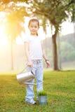 Planta molhando da criança asiática fora Imagem de Stock Royalty Free
