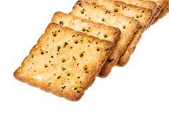 Plantaardige die crackers op wit worden geïsoleerd Stock Afbeeldingen