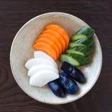Plantaardige groenten in het zuur Stock Afbeeldingen