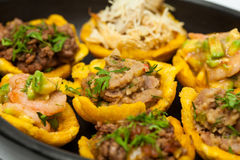 Plantain cups filled with different types of stuffing Stock Photography