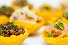 Plantain cups filled with different types of stuffing Royalty Free Stock Photography