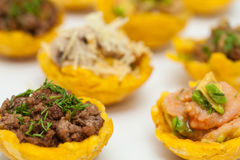 Plantain cups filled with different types of stuffing Royalty Free Stock Photo