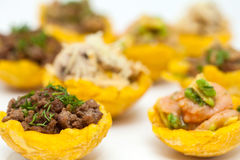 Plantain cups filled with different types of stuffing Royalty Free Stock Photos