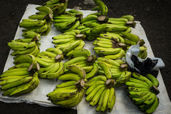 Plantains on top of tarpaulin on sale at traditional market photo taken in Bogor Indonesia Stock Photos
