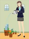 Plantas molhando da mulher Fotos de Stock Royalty Free
