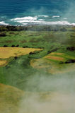 Plantation & Coastline. Aerial view with clouds/mist stock image