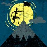 Plantation d'un drapeau sur la montagne Images libres de droits