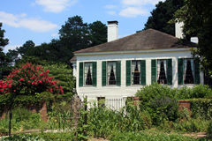 Plantation House. A plantation house dominates the background of this old garden Stock Images