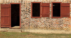 Plantation Quarters. Close up of front door of old brick slave quarters Stock Image