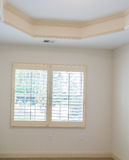 Plantation Shutters in New Bedroom stock image