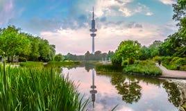 Planten um Blomen park with Heinrich-Hertz-Turm at sunset, Hamburg, Germany Stock Image
