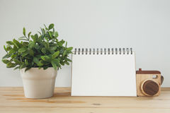 Planter with white paper sign on wood table. Vintage tone Royalty Free Stock Images