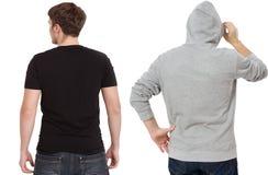 Plantilla de la camiseta y de la camiseta Hombres en camiseta negra y en sudadera con capucha gris Vista posterior trasera Mofa p imagen de archivo libre de regalías