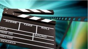 Plantilla de la chapaleta de la película en fondo borroso Foto de archivo libre de regalías