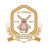 Plantilla de la etiqueta de la harina de trigo con el molino de viento Diseñe el elemento para el logotipo, emblema, muestra, car imagen de archivo