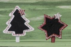 Plantilla de Noel en la madera verde Foto de archivo libre de regalías