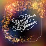 Plantilla del vector con las letras le deseamos una Feliz Navidad Fondo colorido abstracto de la falta de definición y del bokeh Fotos de archivo libres de regalías