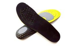 Plantillas ortopédicas para los calzados atléticos Fotos de archivo