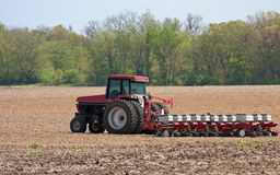 Planting Corn. Farm tractor planting corn in a field Royalty Free Stock Images