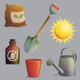 Planting and gardening equipment set. A collection of planting, gardening and agriculture equipment and accessories. Bright shining sun, spade for digging, anti Royalty Free Stock Image