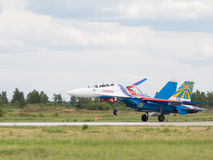 Planting powerful military fighter SU-27 Royalty Free Stock Image