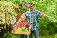 Planting season. Inspect your garden daily to spot insect trouble early. Family dad and daughter little girl planting. Plants. Day at farm. Popular in garden royalty free stock photography